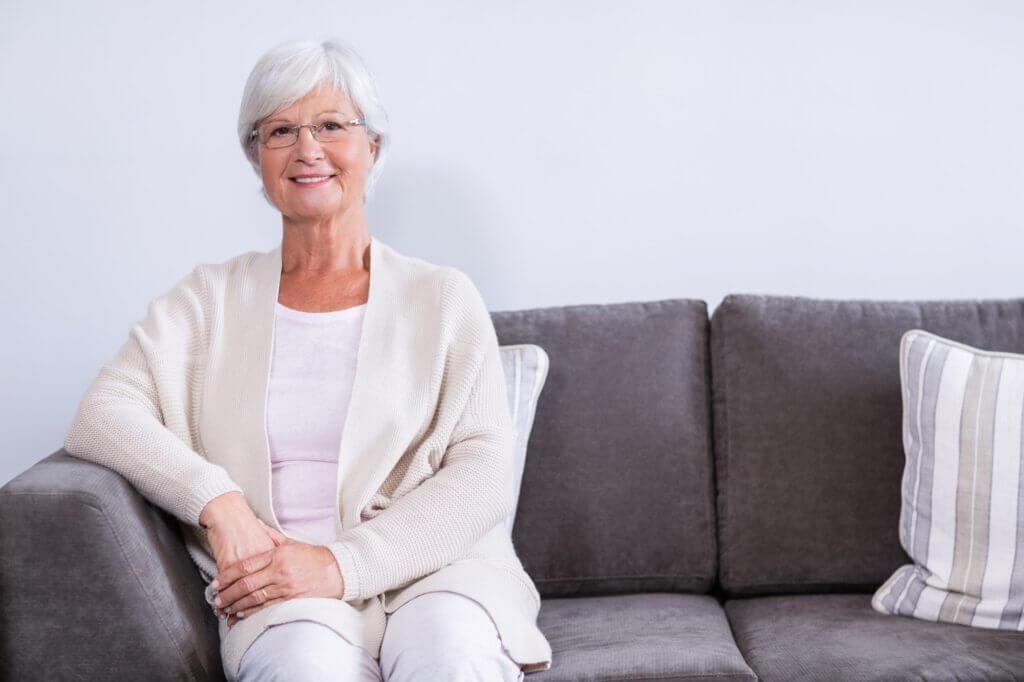Portrait of senior woman sitting on sofa